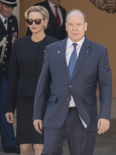Princess Charlene, left, Prince Albert II of Monaco await Chinese President Xi Jinping at Monaco Palace, Sunday, March 24, 2019. Xi is paying the first state visit by a Chinese president to the tiny Mediterranean principality of Monaco on Sunday. (AP Photo/Olivier Anrigo)