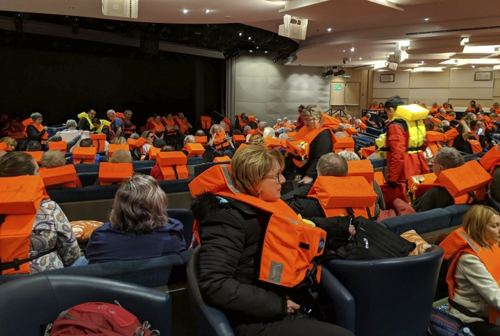 This photo provided by Michal Stewart shows passengers on board the Viking Sky, waiting to be evacuated, off the coast of Norway on Saturday, March 23, 2019. Rescue workers off Norway's western coast rushed to evacuate 1,300 passengers and crew from the disabled cruise ship by helicopter on Saturday, winching them one-by-one to safety as heaving waves tossed the ship from side to side and high winds battered the operation. (Michal Stewart via AP)