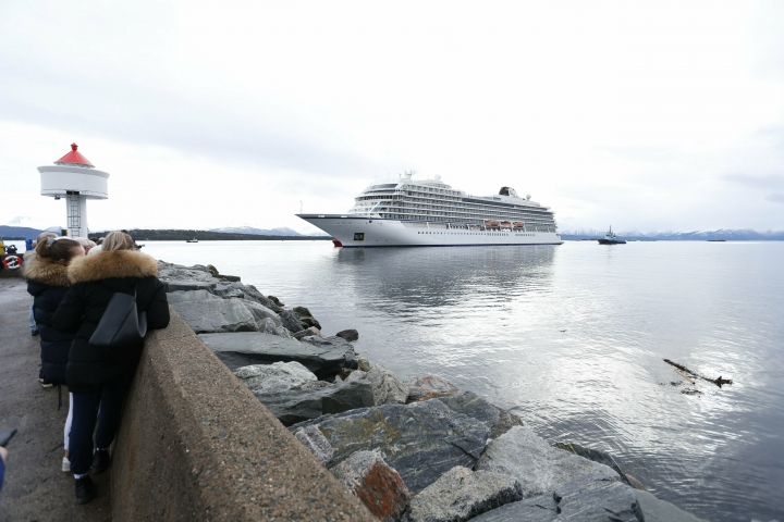 The cruise ship Viking Sky arrives at port off Molde, Norway, Sunday March 24, 2019, after having problems and issuing a Mayday call on Saturday in heavy seas off Norway's western coast. Rescue helicopters took more than 475 passengers from a cruise ship that got stranded off Norway's western coast in bad weather before the vessel departed for a nearby port under escort and with nearly 900 people still on board, the ship's owner said Sunday. (Svein Ove Ekornesvag/NTB scanpix via AP)