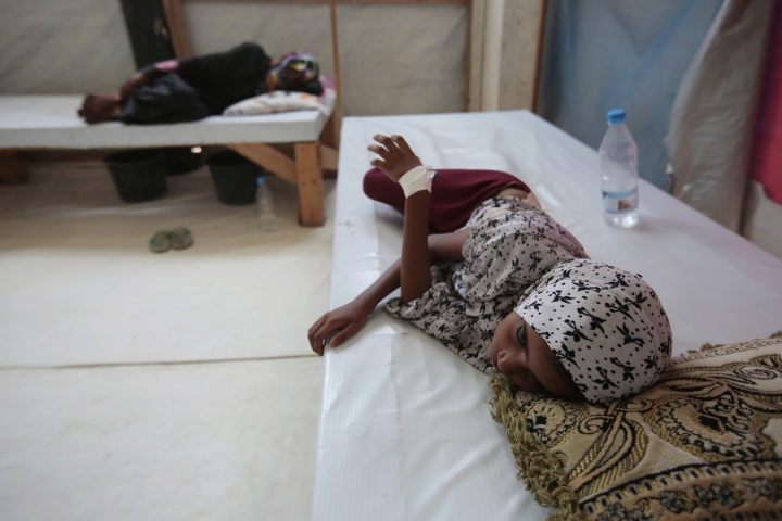 FILE- In this Sept. 27, 2018 file photo, a girl is treated for a suspected cholera infection at a hospital in Hodeida, Yemen. A Monday, March 25, 2019, report from the U.N. Office for the Coordination of Humanitarian Affairs said Yemen has witnessed a sharp spike in the number of suspected cholera cases this year, as well as increased displacement in a northern province. The UN agency said 100,000 suspected cholera cases were found across Yemen from the beginning of the year until March, and over 190 people have died. (AP Photo/Hani Mohammed, File)