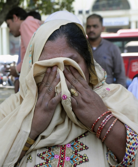 A relative of victims of a 2007 train explosion in India weeps during a protest in Lahore, Pakistan, Monday, March 25, 2019. Family members of Pakistanis killed and injured in an Indian train explosion protested an Indian court's acquittal of four Hindus charged with triggering the blasts 12 years ago, which killed 68 passengers. (AP Photo/K.M. Chaudary)