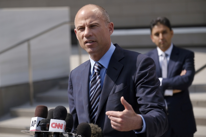 FILE - In this July 27, 2018 file photo, attorney Michael Avenatti replies to questions by reporters during a news conference in front of the U.S. Federal Courthouse in Los Angeles. U.S. prosecutors announced Monday, March 25, 2019, they have charged Avenatti with extortion and bank and wire fraud. A spokesman for the U.S. attorney in Los Angeles said Avenatti was arrested Monday in New York. (AP Photo/Richard Vogel, File)