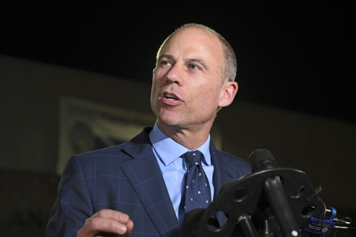FILE - In this Nov. 14, 2018, file photo, Michael Avenatti speaks to the media outside the Los Angeles Police Department Pacific Division after posting bail for a felony domestic violence charge. U.S. prosecutors announced Monday, March 25, 2019 they have charged Avenatti with extortion and bank and wire fraud. A spokesman for the U.S. attorney in Los Angeles said Avenatti was arrested Monday in New York. (AP Photo/Michael Owen Baker, File)