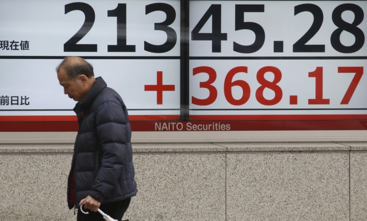 A man walks by an electronic stock board of a securities firm in Tokyo, Tuesday, March 26, 2019. Asian stock prices rebounded Tuesday after global markets slid on worries about U.S. and European economic growth. (AP Photo/Koji Sasahara)
