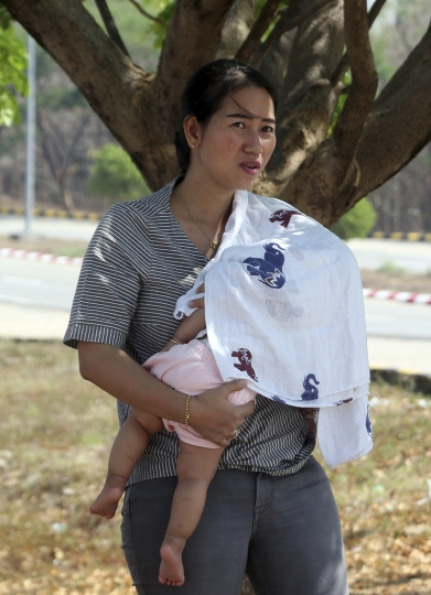 Pan Ei Mon, wife of Reuters journalist Wa Lone, carries her baby on arrival at the Supreme Court in Naypyitaw, Myanmar, Tuesday, March 26, 2019. Myanmar Supreme Court is expected to rule on appeal to overturn conviction of two Reuters journalists sentenced to seven years in prison on charges of violating Myanmar's Official Secrets Act. (AP Photo/Aung Shine Oo)