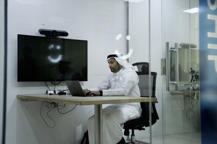 FILE - In this June 24, 2018 file photo, Careem co-founder Abdullah Elyas sits at a desk at the Careem office, in Riyadh, Saudi Arabia. Ride-hailing service Uber announced on Tuesdayh 26, 2019, Marc it has acquired Mideast competitor Careem for $3.1 billion, giving the San Francisco-based firm the commanding edge in a region with a large young, tech-savvy population. (AP Photo/Nariman El-Mofty, File)