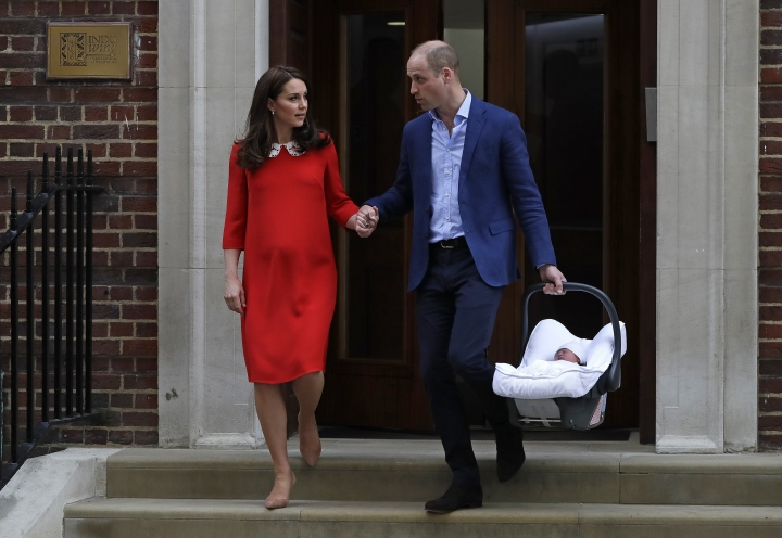FILE - In this April 23, 2018 file photo, Britain's Prince William and Kate, Duchess of Cambridge with their newborn baby son, leave the Lindo wing at St. Mary's Hospital in London London. With another royal baby on the horizon, the debate over postpartum perfection is alive and well. As it stands, we don't know whether Meghan Markle will follow in the footsteps of Kate Middleton when it comes to that magical perfection, but we have an inkling she'll at least slap on some makeup when she introduces the latest royal to the world next month. (AP Photo/Kirsty Wigglesworth, File)