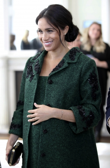 FILE - In this March 11, 2019 file photo, Britain's Meghan, Duchess of Sussex arrive for the Commonwealth Day Youth Event with Prince Harry, at Canada House in London. With another royal baby on the horizon, the debate over postpartum perfection is alive and well. As it stands, we don't know whether Meghan Markle will follow in the footsteps of Kate Middleton when it comes to that magical perfection, but we have an inkling she'll at least slap on some makeup when she introduces the latest royal to the world next month. (Chris Jackson/Pool Photo via AP, File)