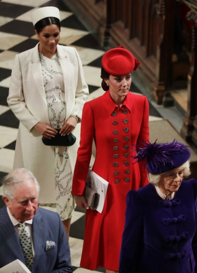 FILE - In this March 11, 2019 file photo, Britain's Kate, Duchess of Cambridge and Meghan, Duchess of Sussex leave after attending the Commonwealth Service at Westminster Abbey in London. With another royal baby on the horizon, the debate over postpartum perfection is alive and well. As it stands, we don't know whether Meghan Markle will follow in the footsteps of Kate Middleton when it comes to that magical perfection, but we have an inkling she'll at least slap on some makeup when she introduces the latest royal to the world next month. (AP Photo/Kirsty Wigglesworth, Pool)