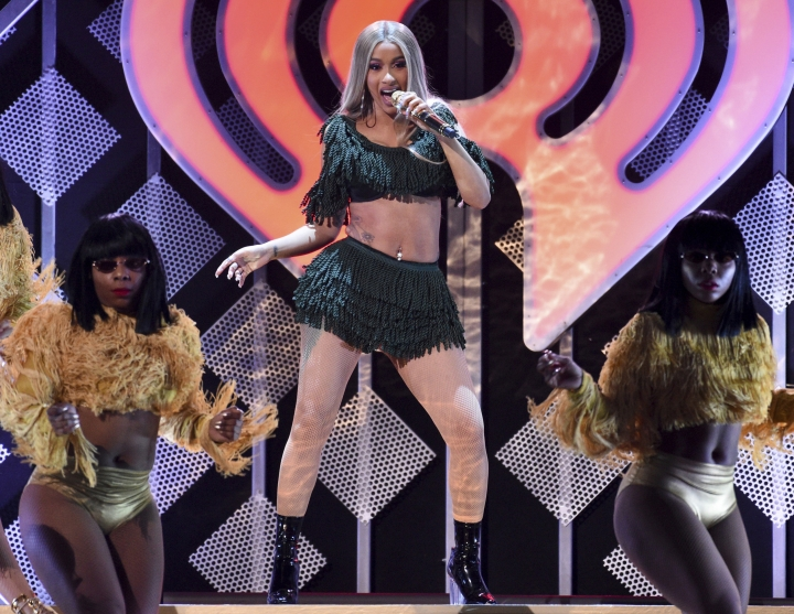 "FILE - In this Dec. 7, 2018 file photo, hip-hop recording artist Cardi B performs at Z100's iHeartRadio Jingle Ball in New York. Cardi B is trying to clarify herself after a video surfaced online where the rapper said she drugged and robbed men for money. The Grammy winner posted a statement Tuesday, March 26, 2019, on Instagram that she had ""very limited options"" and needed to do anything to ""survive."" The former stripper says she wasn't trying to glorify her actions, but felt it was necessary at the time.(Photo by Evan Agostini/Invision/AP, File)"