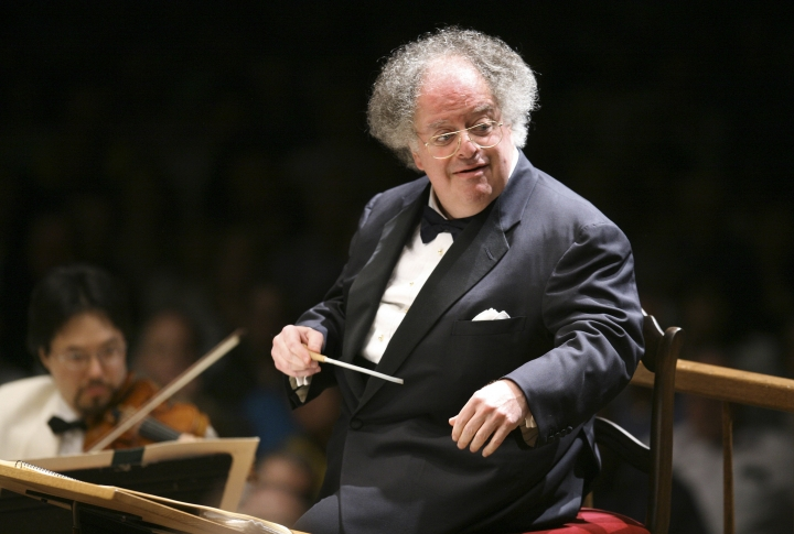 FILE - In this July 7, 2006 file photo, Boston Symphony Orchestra music director James Levine conducts the symphony on its opening night performance at Tanglewood in Lenox, Mass. A New York judge dismissed two of the seven counts and part of a third in the lawsuit filed by the former Metropolitan Opera music director against the company last year. Levine was the Met's music or artistic director from 1976-2016, then became music director emeritus. He was fired by the Met on March 12 last year after the company said an investigation found evidence of sexual abuse and harassment. (AP Photo/Michael Dwyer, File)