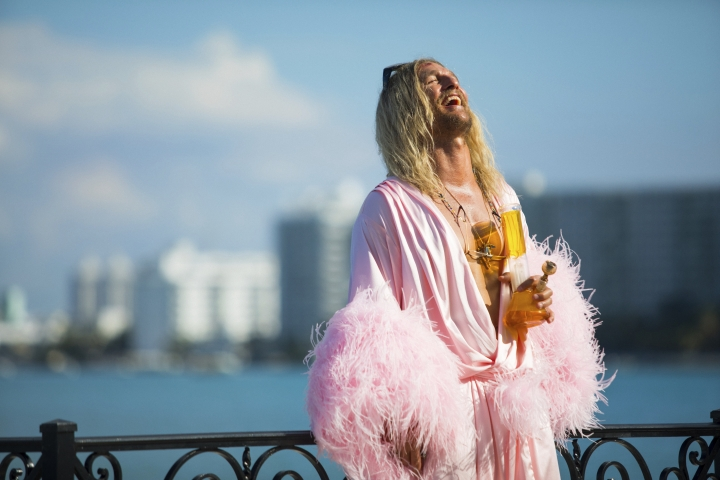 """This image released by Neon shows Matthew McConaughey in a scene from """"The Beach Bum."""" (Atsushi Nishijima/Neon via AP)"""