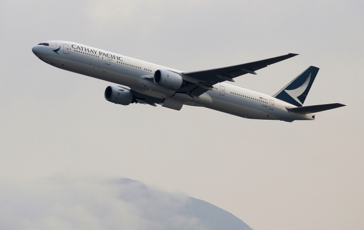 In this March 26, 2019 photo, a Cathay Pacific Airways passenger aircraft takes off at the Hong Kong International Airport. Cathay Pacific Airways is acquiring Hong Kong-based budget airline HK Express. Cathay said Wednesday, March 27, 2019, it will pay 4.93 billion Hong Kong dollars ($628 million) for HK Express. It said the acquisition will retain its identity as a separate brand and be operated as a low-cost carrier. (AP Photo/Kin Cheung)