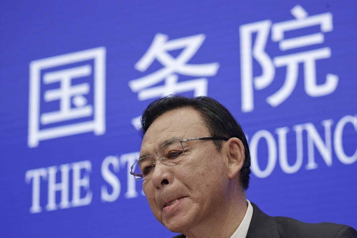 Tibet Executive vice governor Norbu Dondrup bites his lips during a press conference at the State Council Information Office in Beijing, Wednesday, March 27, 2019. Chinese officials responsible for Tibet are praising development in the Himalayan region in the 60 years since the suppression of an uprising against Beijing's rule. Norbu Dondrup on Wednesday reviewed gains in the economy, health care and education since 1959 and castigated the self-declared government-in-exile established by Buddhist leader the Dalai Lama as illegitimate. The now-83-year-old Dalai Lama fled to India after the uprising was suppressed. (AP Photo/Andy Wong)