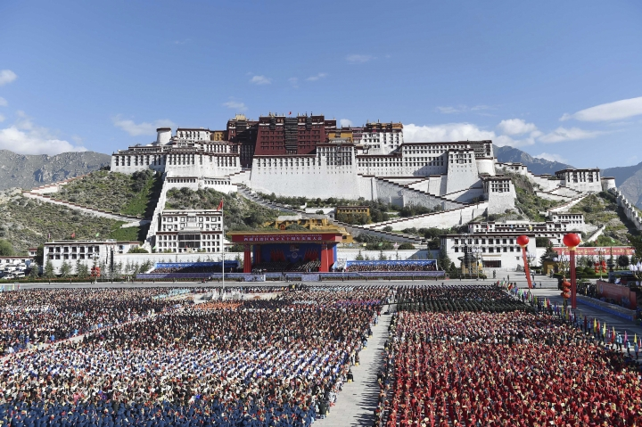 FILE - In this Sept. 8, 2015, file photo released by China's Xinhua News Agency, a grand ceremony marking the 50th anniversary of the founding of the Tibet Autonomous Region is held at the square of the Potala Palace in Lhasa, capital of southwest China's Tibet Autonomous Region. Chinese officials responsible for Tibet are praising development in the Himalayan region in the 60 years since the 1959 suppression of an uprising against Beijing's rule. (Chen Yehua/Xinhua via AP, File)