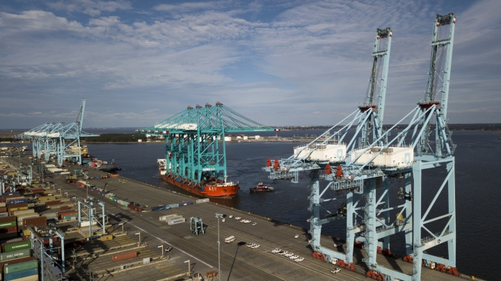 FILE- In this Jan. 7, 2019, file photo a Chinese ship carrying giant cranes approaches the pier at Virginia International GatewayTerminal in Portsmouth, Va. On Wednesday, March 27, the Commerce Department reports on the U.S. trade gap for January. (AP Photo/Steve Helber, File)