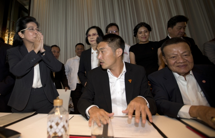 Pheu Thai party's candidate for prime minister Sudarat Keyuraphan left, and Future Forward Party leader Thanathorn Juangroongruangkit, center leave after a press conference Bangkok, Thailand Wednesday, March 27, 2019. Seven political parties led by the flagship party loyal to former Prime Minister Thaksin Shinawatra have come together in a coalition to try to form Thailand's next government, even though the results of Sunday's general election will be formally announced only on May 9.(AP Photo/Sakchai Lalit)