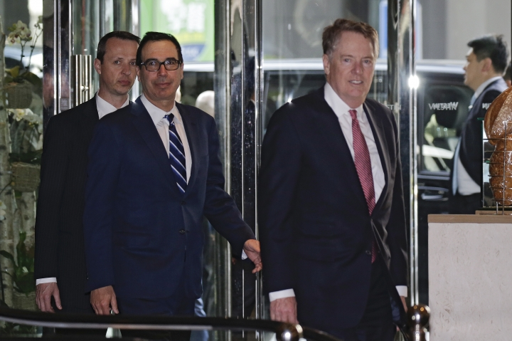 U.S. Treasury Secretary Steven Mnuchin, center, and his Trade Representative Robert Lighthizer, right, arrive at a hotel in Beijing, Thursday, March 28, 2019. Mnuchin and his Trade Representative Robert Lighthizer arrive at China's capital to hold a new round of high-level trade talks with China on March 28-29, start with a working dinner. (AP Photo/Andy Wong)