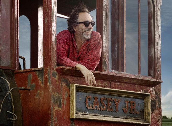 """This image released by Disney shows director Tim Burton on the set of """"Dumbo."""" (Leah Gallo/Disney via AP)"""