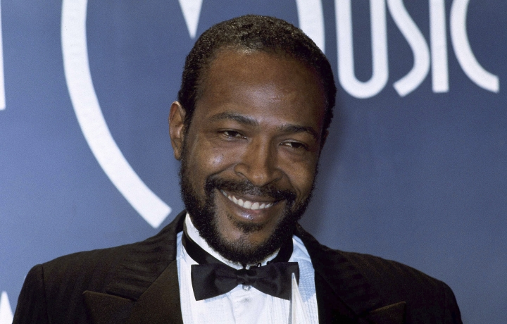 """FILE - In this Jan. 17, 1983, file photo, singer-songwriter Marvin Gaye, winner of Favorite Soul/R&B Single, """"Sexual Healing,"""" attends the American Music Awards in Los Angeles. Clothing, including a knit cap and military-style jacket and pants, worn by Gaye will go on display at the Motown Museum in Detroit as part of the music label's 60th anniversary celebration. Pictures of the items will be posted on Facebook Friday and displayed at the museum beginning Saturday through the end of April. (AP Photo/Doug Pizac, File)"""