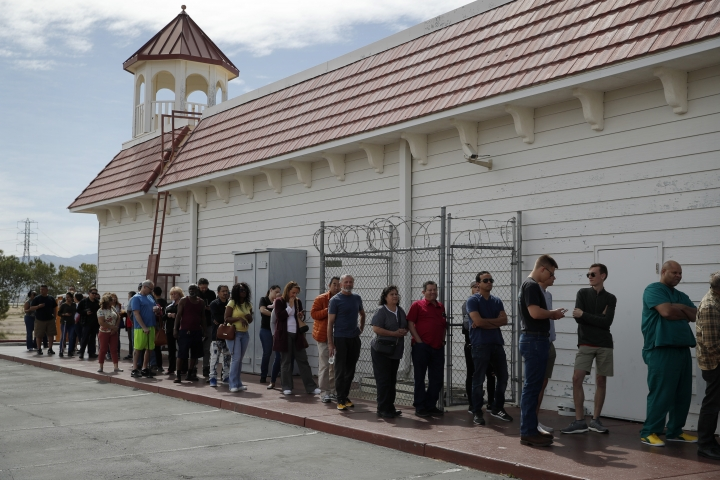 People wait in line for lottery tickets at the Lotto Store at Primm just inside the California border Wednesday, March 27, 2019, near Primm, Nev. The Powerball jackpot soared to a massive $750 million Wednesday. (AP Photo/John Locher)