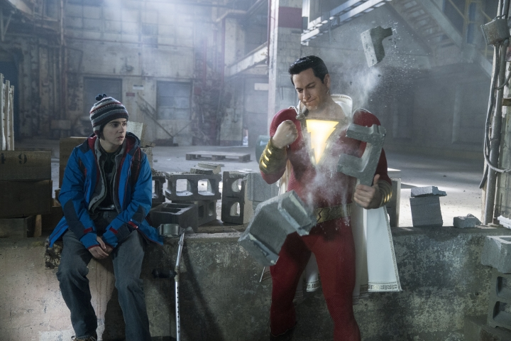 "This image released by Warner Bros. shows Zachary Levi, right, and Jack Dylan Grazer in a scene from ""Shazam!"" (Steve Wilkie/Warner Bros. Entertainment via AP)"
