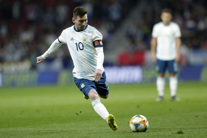 Argentina's Lionel Messi runs with the ball during an international friendly soccer match between Argentina and Venezuela at Wanda Metropolitano stadium in Madrid, Spain, Friday, March 22, 2019. (AP Photo/Bernat Armangue)