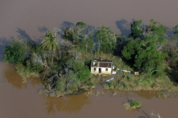 A house surrounded by flood water near Beira, Mozambique, Thursday, March 28, 2019. The first cases of cholera have been confirmed in the cyclone-ravaged city of Beira, Mozambican authorities announced on Wednesday, raising the stakes in an already desperate fight to help hundreds of thousands of people sheltering in increasingly squalid conditions. (AP Photo/Themba Hadebe)