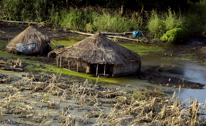 Submerged huts near Beira, Mozambique, Thursday, March 28, 2019. The first cases of cholera have been confirmed in the cyclone-ravaged city of Beira, Mozambican authorities announced on Wednesday, raising the stakes in an already desperate fight to help hundreds of thousands of people sheltering in increasingly squalid conditions. (AP Photo/Themba Hadebe)