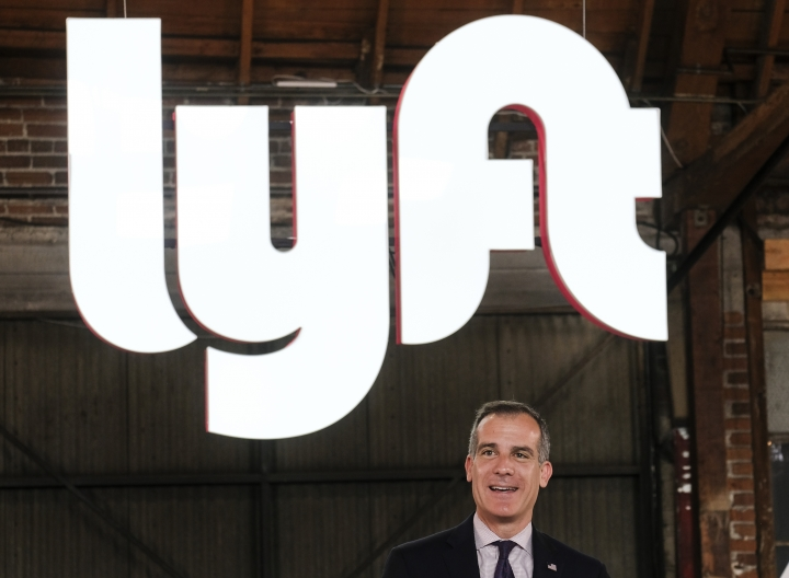 "Los Angeles mayor Eric Garcetti speaks during and event for Lyft in Los Angeles, Friday, March 29, 2019. On Friday the San Francisco company's stock will begin trading on the Nasdaq exchange under the ticker symbol ""LYFT."" (AP Photo/Ringo H.W. Chiu)"