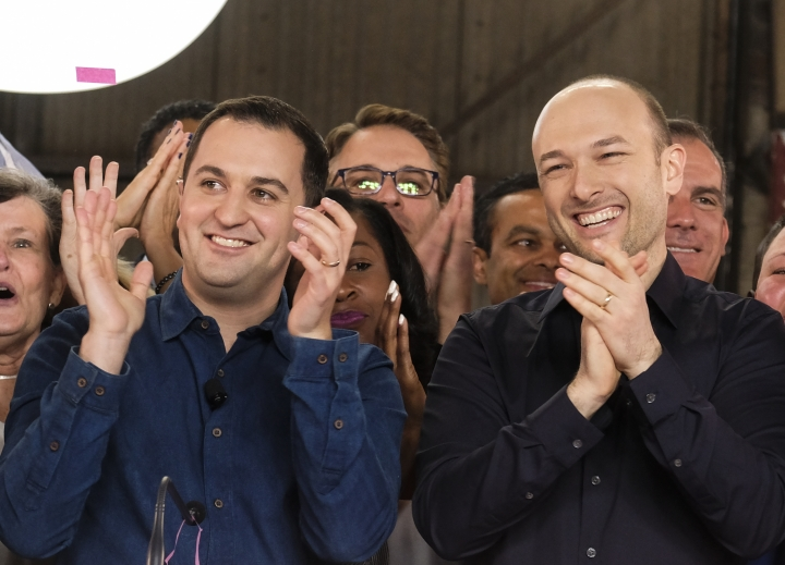 "Lyft co-founders John Zimmer, left, and Logan Green cheer as they as they ring a ceremonial opening bell in Los Angeles, Friday, March 29, 2019. On Friday the San Francisco company's stock will begin trading on the Nasdaq exchange under the ticker symbol ""LYFT."" (AP Photo/Ringo H.W. Chiu)"