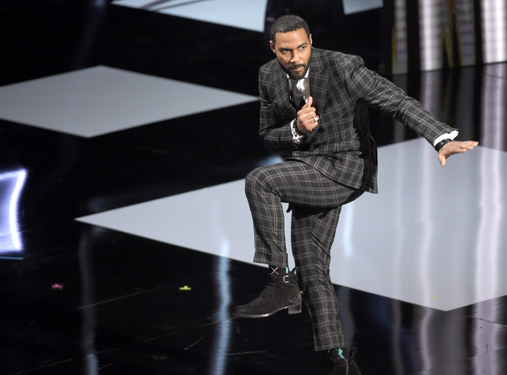 """Omari Hardwick gestures as he appears on stage to accept the award for outstanding actor in a drama series for """"Power"""" at the 50th annual NAACP Image Awards on Saturday, March 30, 2019, at the Dolby Theatre in Los Angeles. (Photo by Chris Pizzello/Invision/AP)"""