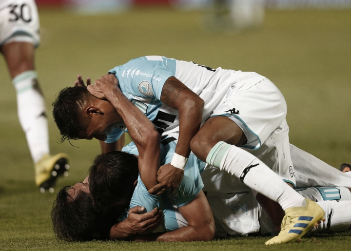 Racing Club's midfielder Augusto Solari celebrates with his teammates after scoring against Tigre during an Argentine Superliga soccer match in Victoria, on the outskirts of Buenos Aires, Argentina, Sunday, March 31, 2019. (AP Photo/Mariano Blanc)
