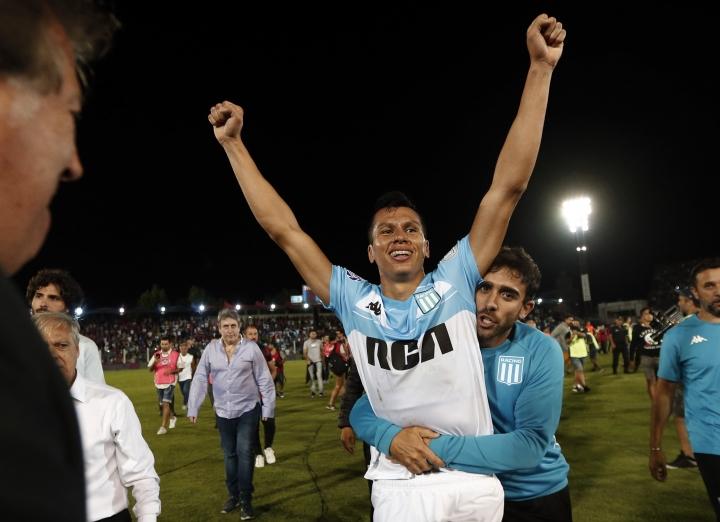 Racing Club's defender Leonardo Sigali, teammates and staff celebrate clinching the Argentine Superliga Championship title, after a match against Tigre, in Victoria on the outskirts of Buenos Aires, Argentina, Sunday, March 31, 2019. Racing Club tied with Tigre but won the title on points. (AP Photo/Mariano Blanc)