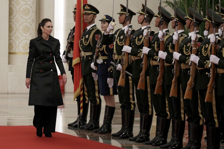 New Zealand Prime Minister Jacinda Ardern reviews an honor guard with Chinese Premier Li Keqiang during a welcome ceremony at the Great Hall of the People in Beijing, Monday, April 1, 2019. (AP Photo/Andy Wong)