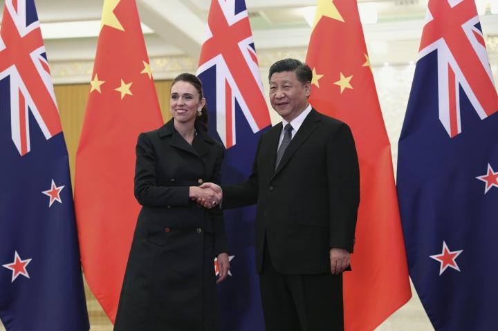Chinese President Xi Jinping, right, and New Zealand Prime Minister Jacinda Ardern shake hands before their meeting at the Great Hall of the People in Beijing, Monday, April 1, 2019. (Kenzaburo Fukuhara/Pool Photo via AP)