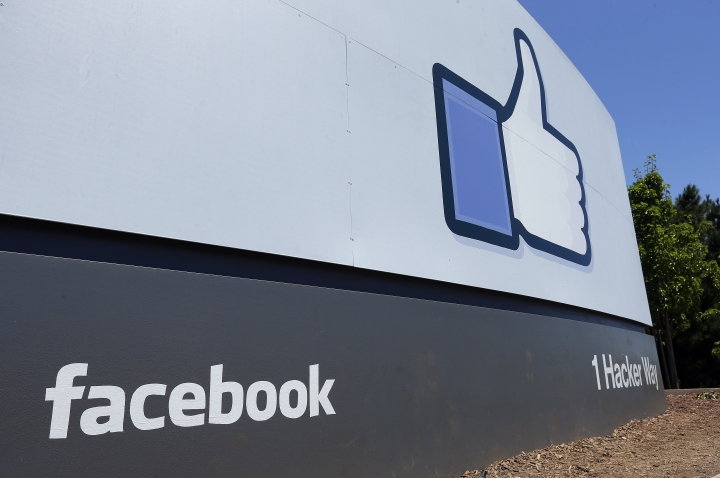 FILE - This July 16, 2013 file photo shows a sign at Facebook headquarters in Menlo Park, Calif. Facebook said Friday March 29, 2019, that it's beefing up its requirements for political advertising ahead of European Union elections in May. (AP Photo/Ben Margot, File)