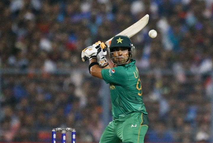 FILE - In this Saturday, March 19, 2016 file photo, Pakistan's Umar Akmal, bats during the ICC World Twenty20 2016 cricket match against India at Eden Gardens in Kolkata, India. Pakistan middle order batsman Umar Akmal has been fined 20% of his match fee for breaking a team curfew ahead of the fifth and final one-day international against Australia on Sunday. The Pakistan Cricket Board said in a statement on Monday April 1, 2019 that Akmal apologized for his actions and accepted the sanction. (AP Photo/Bernat Armangue, File)