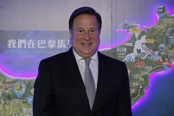 Panama President Juan Carlos Varela Rodríguez poses for photographers before a conference on the Panama invest in Hong Kong, Tuesday, April 2, 2019. Panama President Varela says his country sees 'big opportunity' in China's 'belt and road' infrastructure initiative. (AP Photo/Kin Cheung)