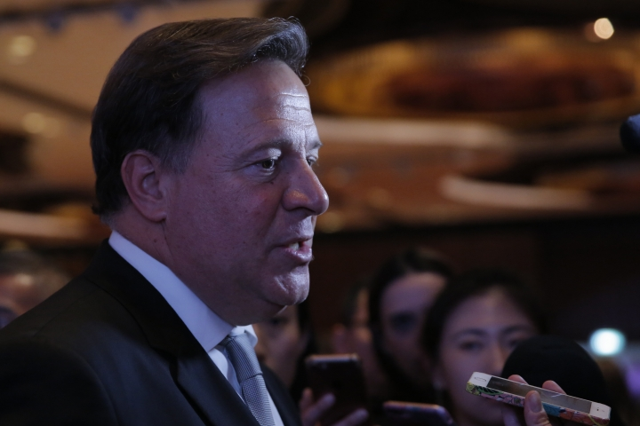 Panama President Juan Carlos Varela Rodríguez speaks to the media after a conference on the Panama invest in Hong Kong, Tuesday, April 2, 2019. Panama President Varela says his country sees 'big opportunity' in China's 'belt and road' infrastructure initiative. (AP Photo/Kin Cheung)