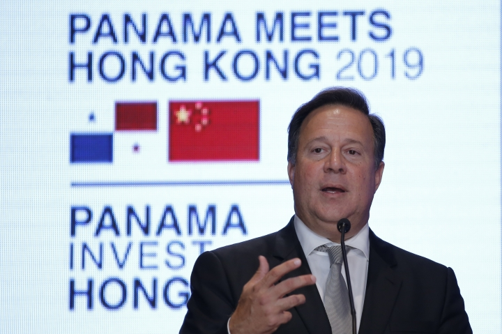 Panama President Juan Carlos Varela Rodríguez delivers a speech at a conference on the Panama invest in Hong Kong, Tuesday, April 2, 2019. Panama President Varela says his country sees 'big opportunity' in China's 'belt and road' infrastructure initiative. (AP Photo/Kin Cheung)