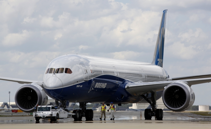 "FILE - In this March 31, 2017, file photo, Boeing employees walk the new Boeing 787-10 Dreamliner down towards the delivery ramp area at the company's facility in South Carolina after conducting its first test flight at Charleston International Airport in North Charleston, S.C. Singapore Airlines says it has grounded two of its Boeing 787-10 aircraft due to engine issues. The carrier in a statement on Tuesday, April 2, 2019, that ""premature blade deterioration was found on some engines"" of its 787-10 fleet at recent routine inspections.(AP Photo/Mic Smith, File)"