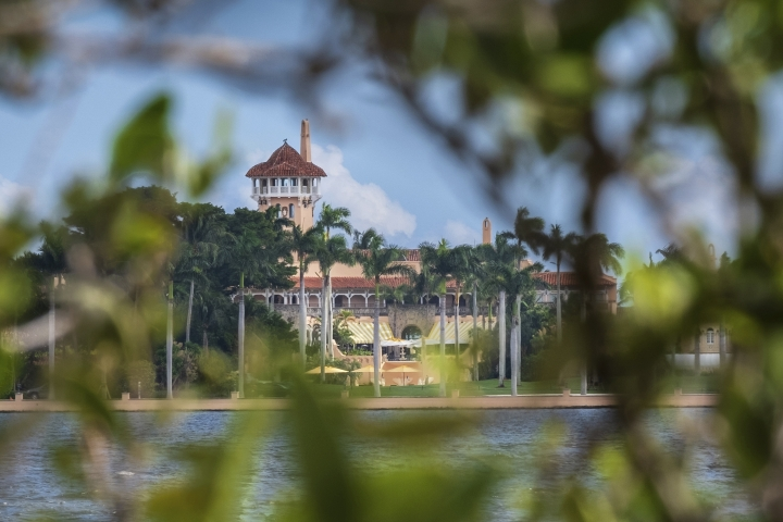 FILE - This Nov. 23, 2018 file photo shows President Donald Trump's Mar-a-Lago estate behind mangrove trees in Palm Beach, Fla. On Saturday, March 30, 2019, a woman carrying two Chinese passports and a device containing computer malware lied to Secret Service agents and briefly gained admission to the club over the weekend during his Florida visit, federal prosecutors allege in court documents. (AP Photo/J. David Ake)
