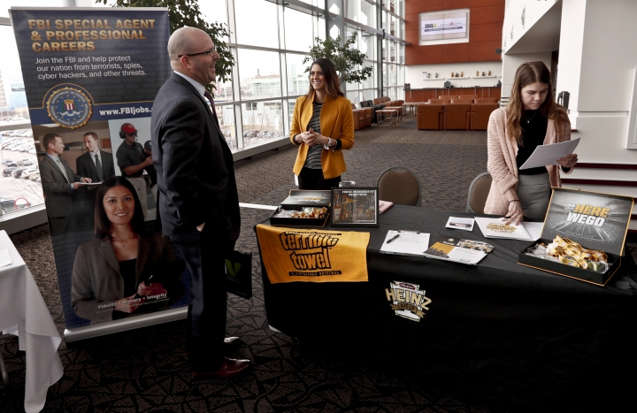 FILE- In this March 7, 2019, photo visitors to the Pittsburgh veterans job fair meet with recruiters at Heinz Field in Pittsburgh. On Wednesday, April 3, payroll processor ADP reports how many jobs private employers added in March. (AP Photo/Keith Srakocic, File)