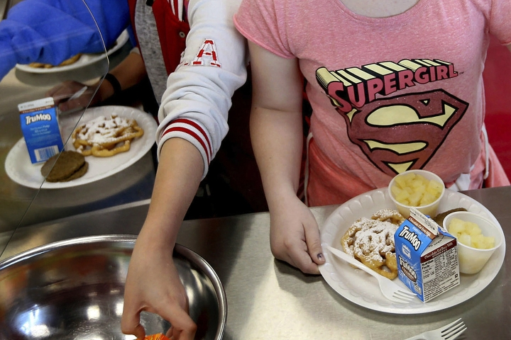 FILE - In this Friday, May 19, 2017 file photo, students line up for lunch at a middle school in Sandy, Utah. New York has joined five other states and the District of Columbia that have sued the Department of Agriculture, accusing the federal agency of weakening nutritional standards in school meals.The lawsuit was filed on Wednesday, April 3, 2019 in Manhattan federal court. (Laura Seitz/The Deseret News via AP)