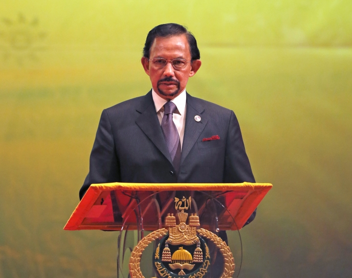 In this Oct, 10, 2013, photo, Brunei's Sultan Hassanal Bolkiah speaks during the closing ceremony and handover of the ASEAN Chairmanship to Myanmar in Bandar Seri Begawan. The sultan announced to implement Islamic criminal laws that punishes gay sex by stoning offenders to death. The legal change in the tiny, oil-rich monarchy, which also includes amputation for theft, is due to come into force Wednesday, April 3, 2019. (AP Photo/Vincent Thian)