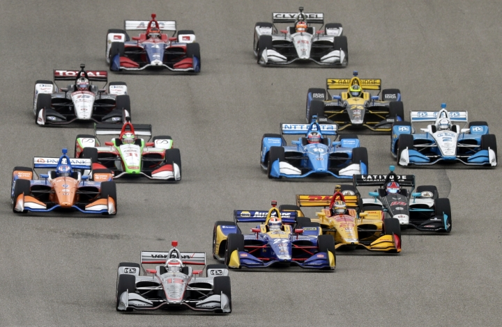 Will Power (12) of Australia, Alexander Rossi (27) and Ryan Hunter-Reay (28) lead the field into Turn 1 at the start of the IndyCar Classic auto race, Sunday, March 24, 2019, in Austin, Texas. (AP Photo/Eric Gay)