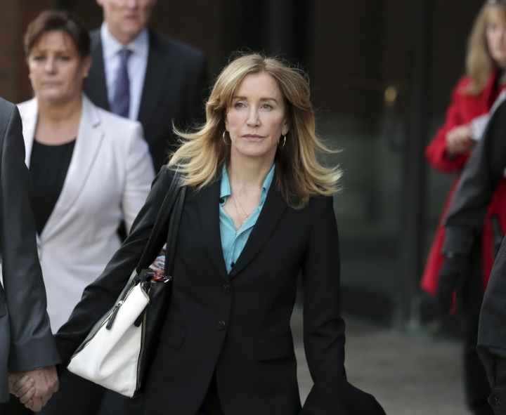 Actress Felicity Huffman departs federal court in Boston on Wednesday, April 3, 2019, after facing charges in a nationwide college admissions bribery scandal. (AP Photos/Charles Krupa)