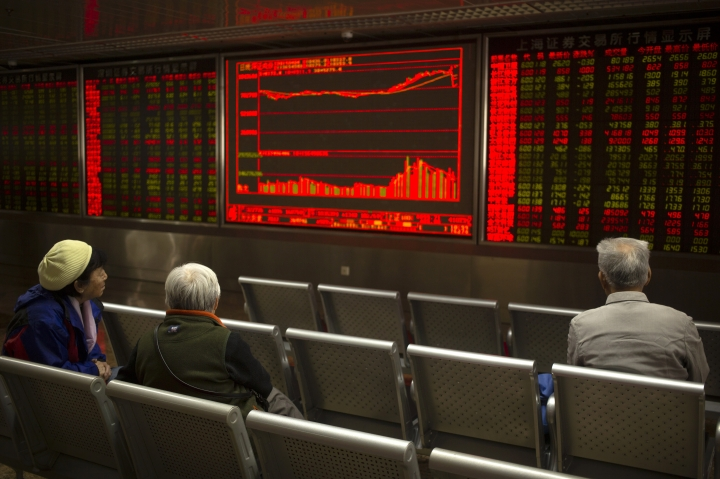 Chinese investors monitor stock prices at a brokerage house in Beijing, Thursday, April 4, 2019. Shares were mixed in Asia on Thursday after modest gains overnight on Wall Street.(AP Photo/Mark Schiefelbein)