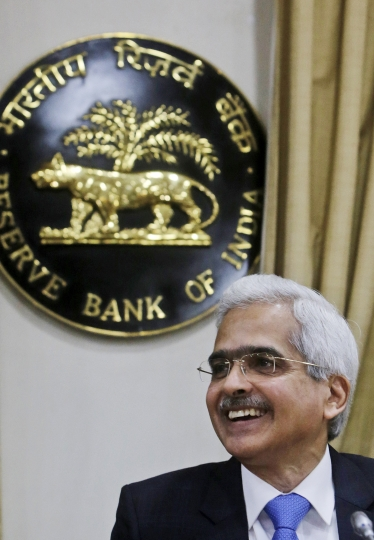 Reserve Bank of India Governor Shaktikanta Das smiles during a press conference to announce the first bi monthly monetary policy in Mumbai, India, Thursday, April 4, 2019. (AP Photo/Rajanish Kakade)
